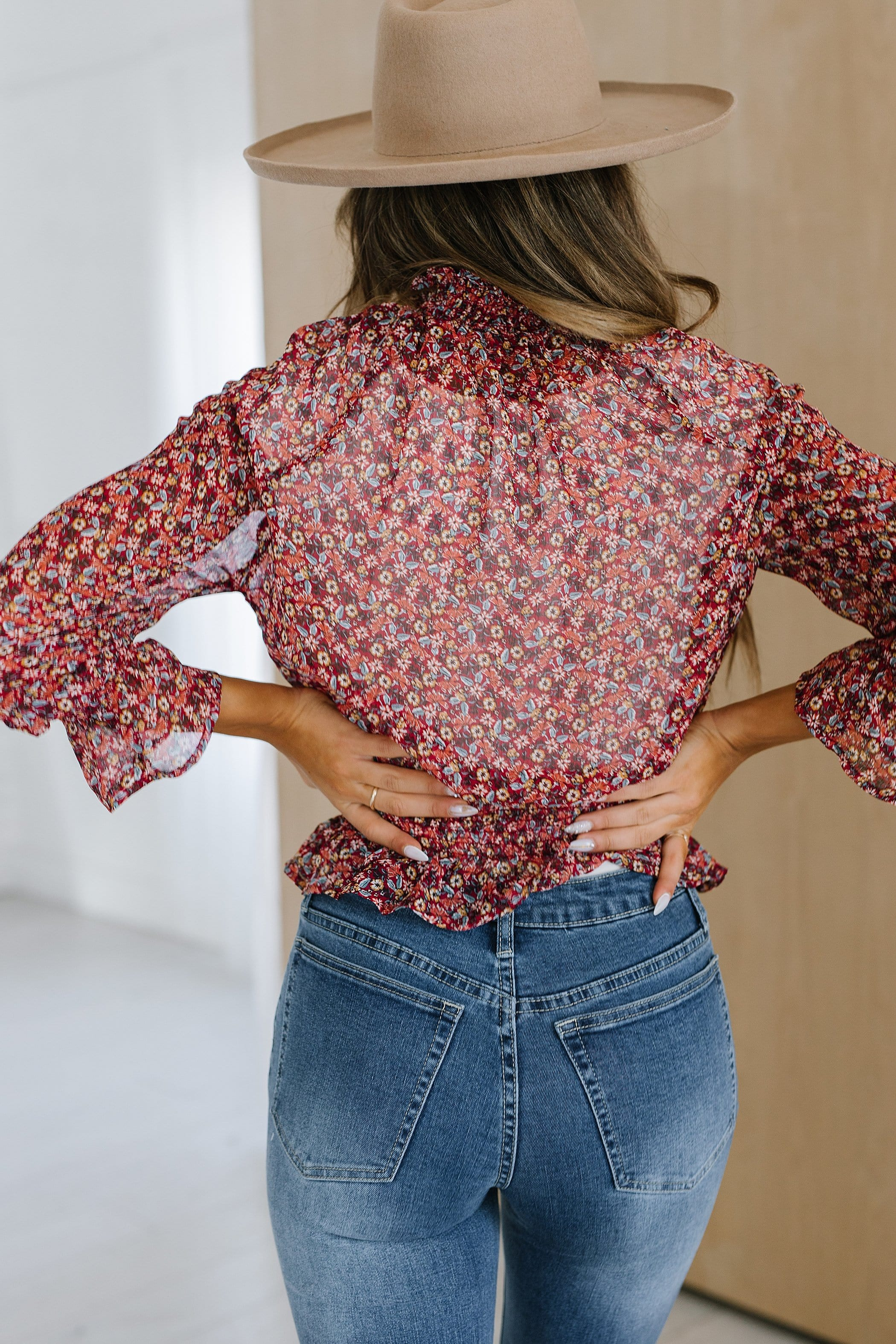 The Felicity Floral Smocked Top in Burgundy