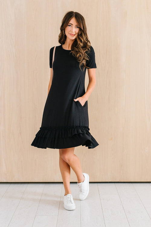 The Lindsey Ruffle Hem Dress in Black, Blue Grey, Copper, Coral, and Rose