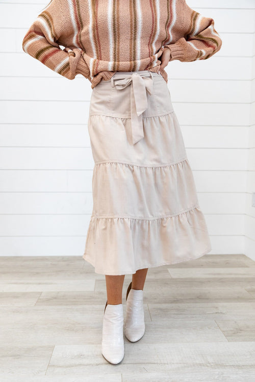 The Siana Tiered Midi Skirt in Beige