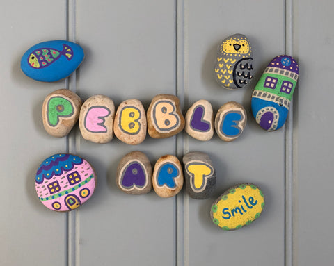 Examples of pebble art painted with Posca paint marker pens