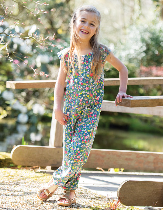 Frugi Maya jumpsuit in rabbit field print. Made from organic cotton.