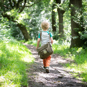 Boy walking with Original Den Kit in bag