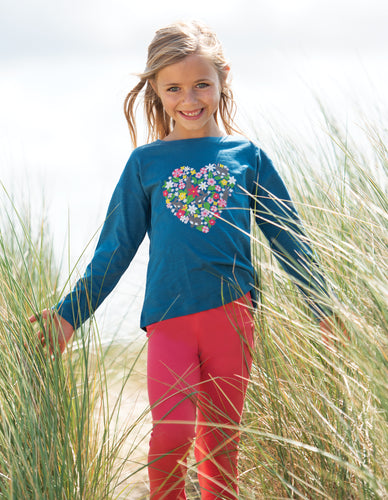 Frugi Libby leggings in watermelon colour. Made from organic cotton.