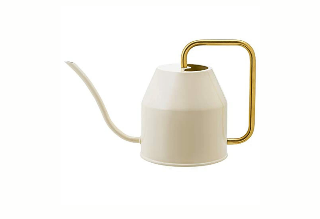White and gold watering can