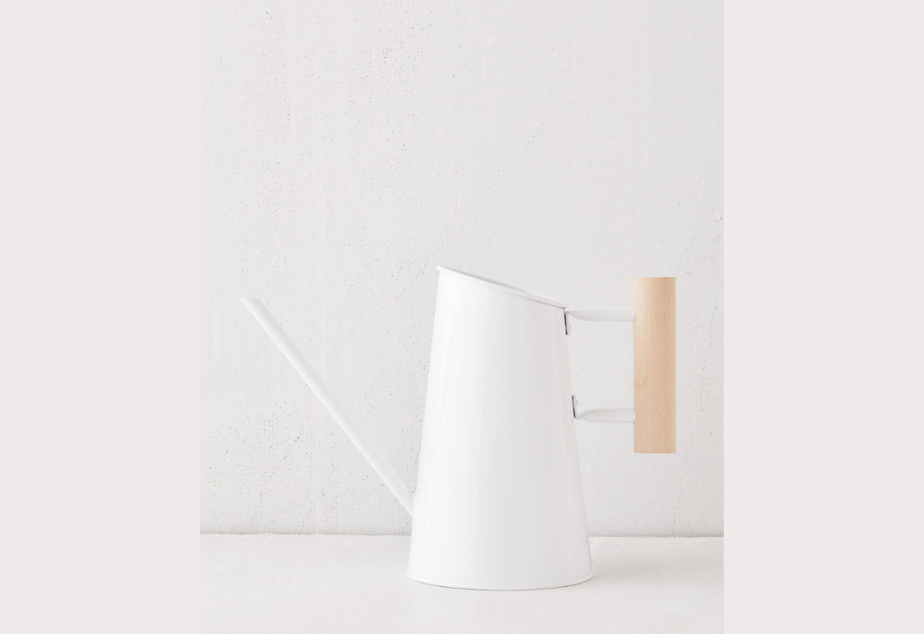 White and wood watering can