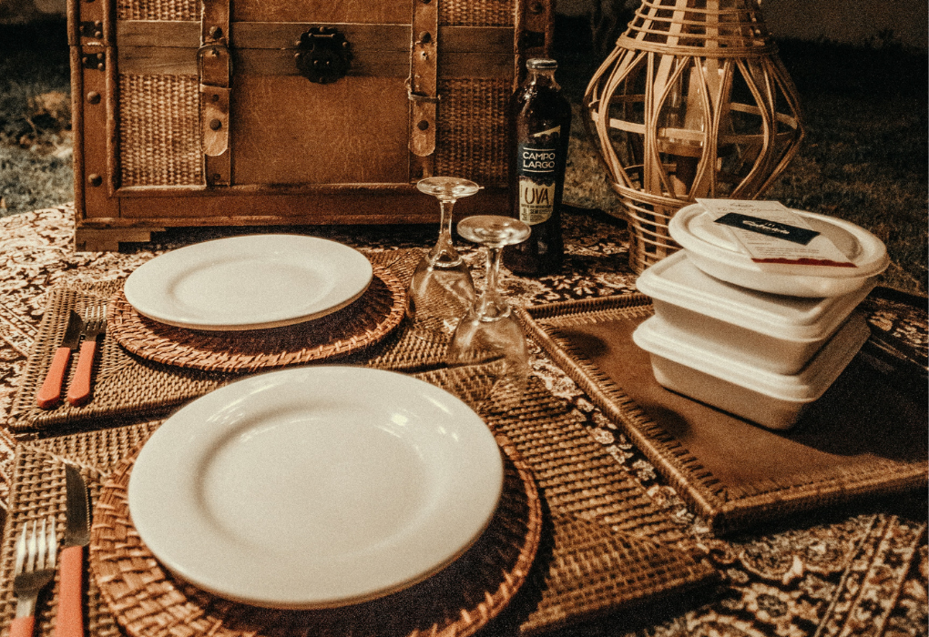 Cozy tablescape with woven placemats and take-out boxes on the side