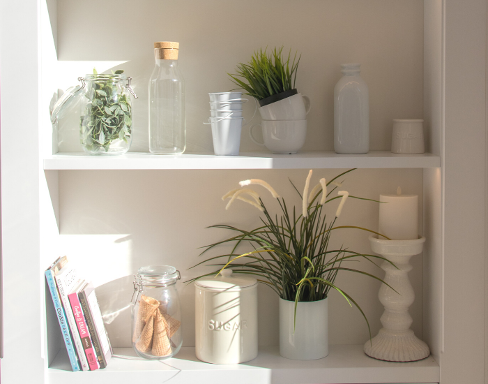 Open shelf with plants and decor