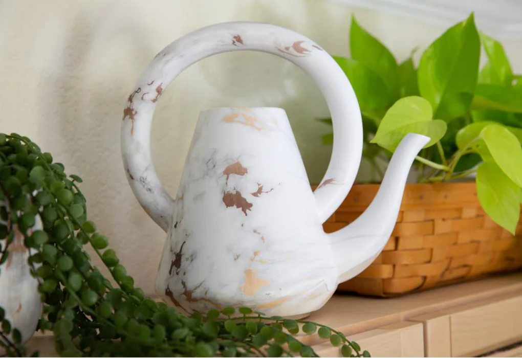 Gold and marble watering can