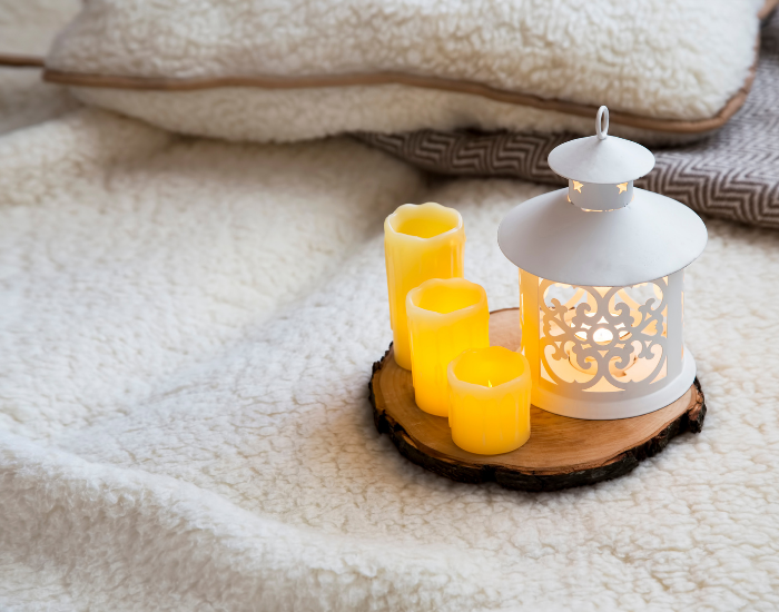 Cozy candles and cozy blanket for winter decoration