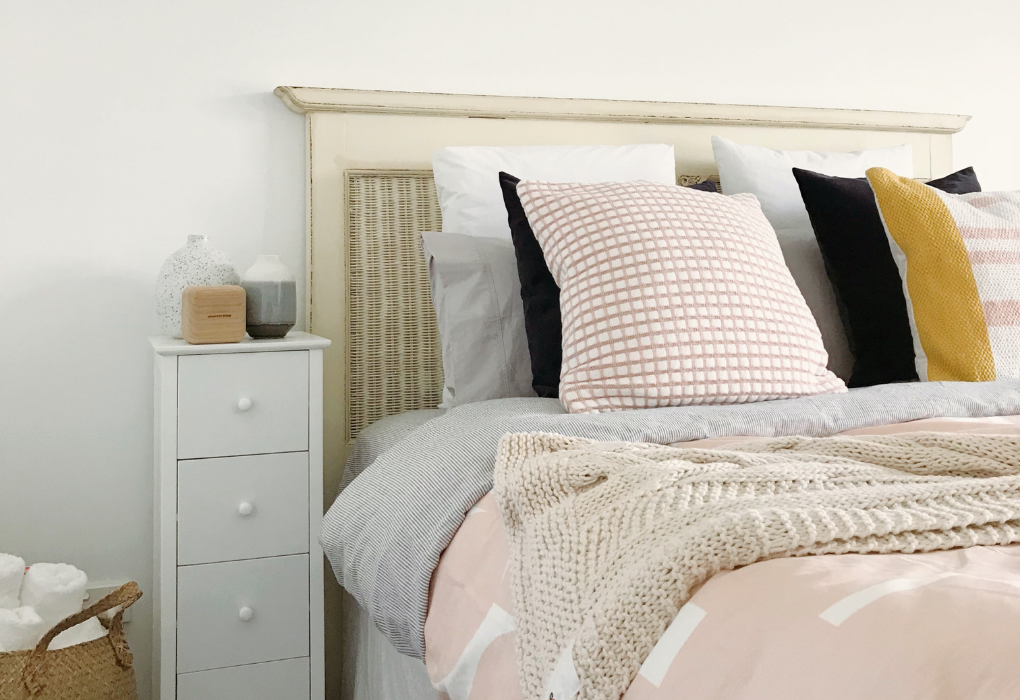 Pastel colored pillowcases and bed cover