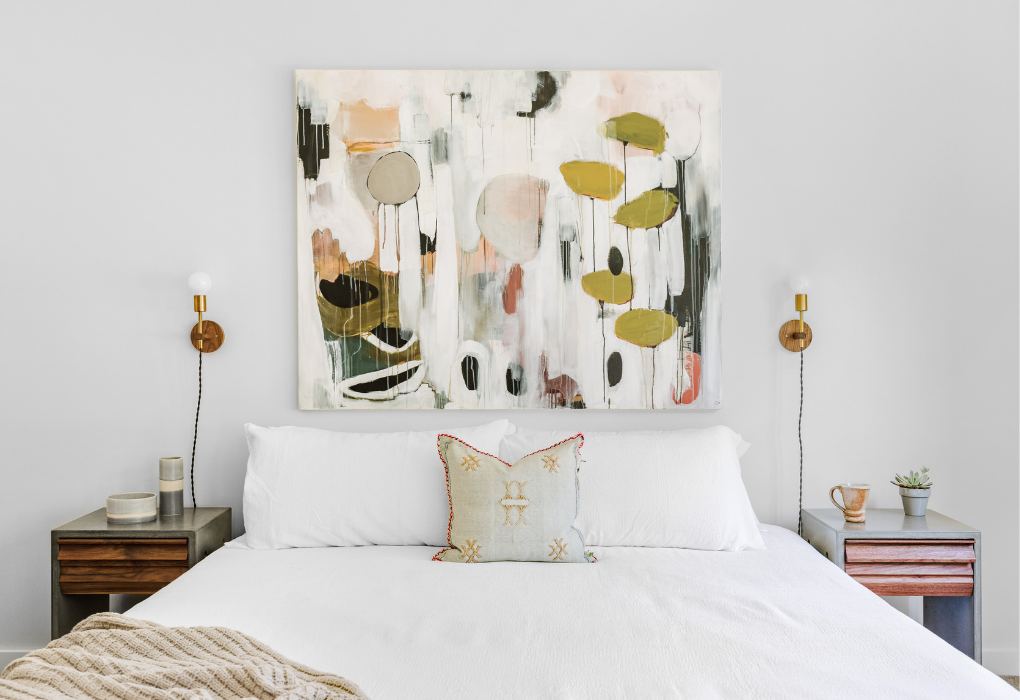 Bedroom with a large abstract wall art above the bed