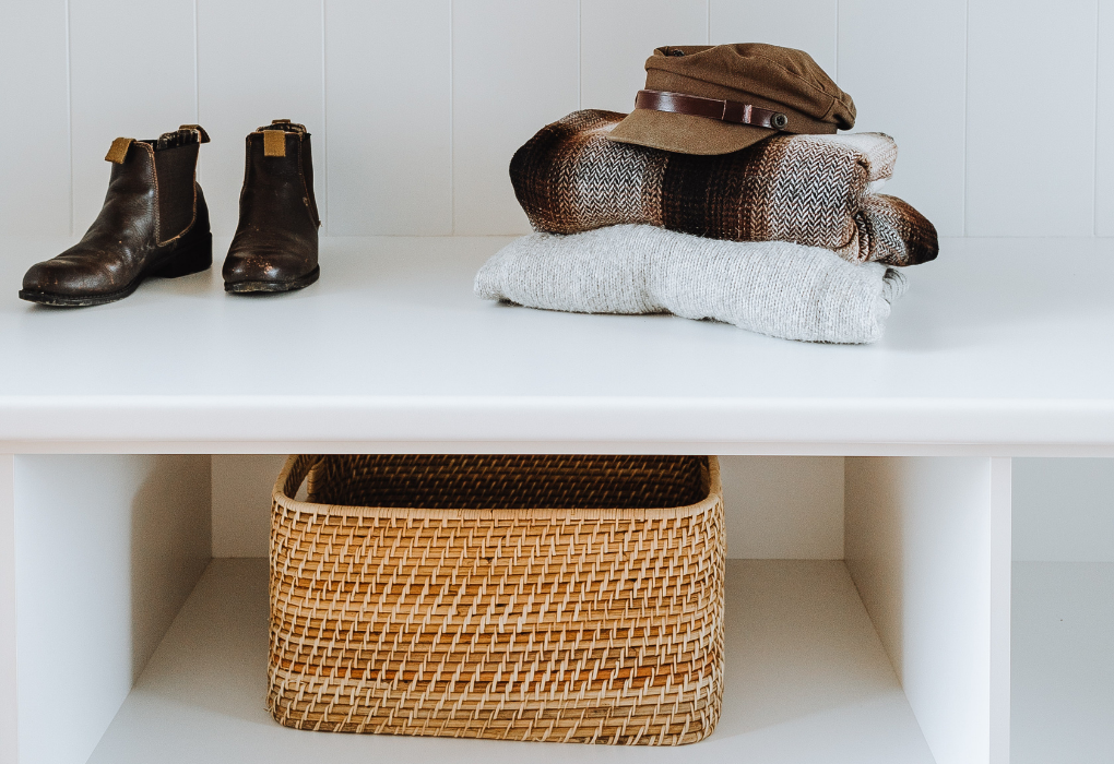 Woven basket storage for shoes in entryway