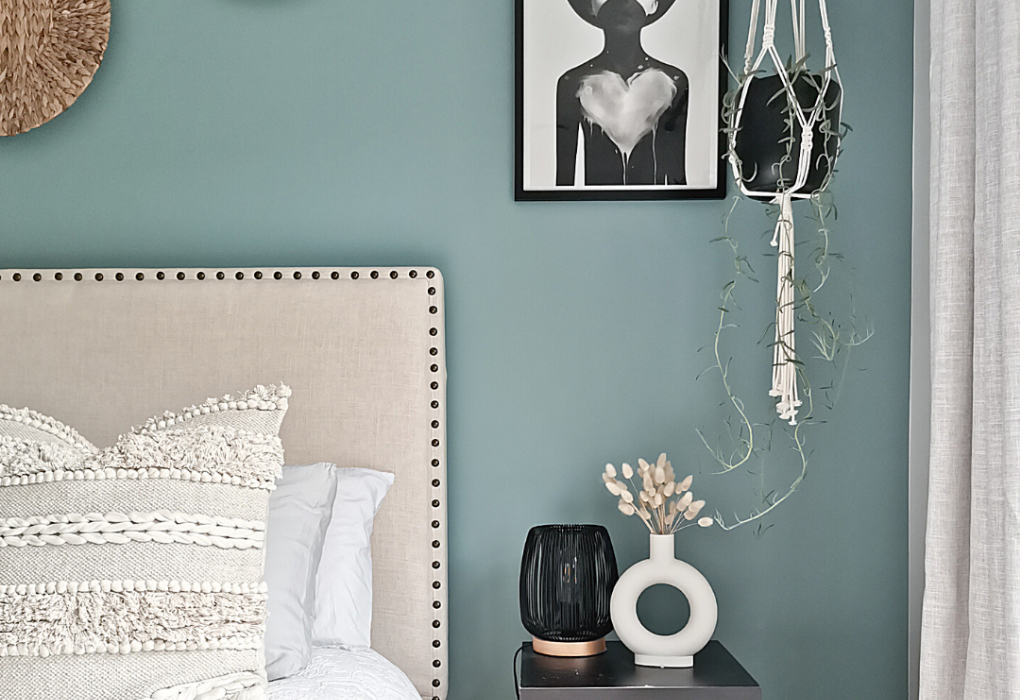 Blue-green accent wall for bedroom