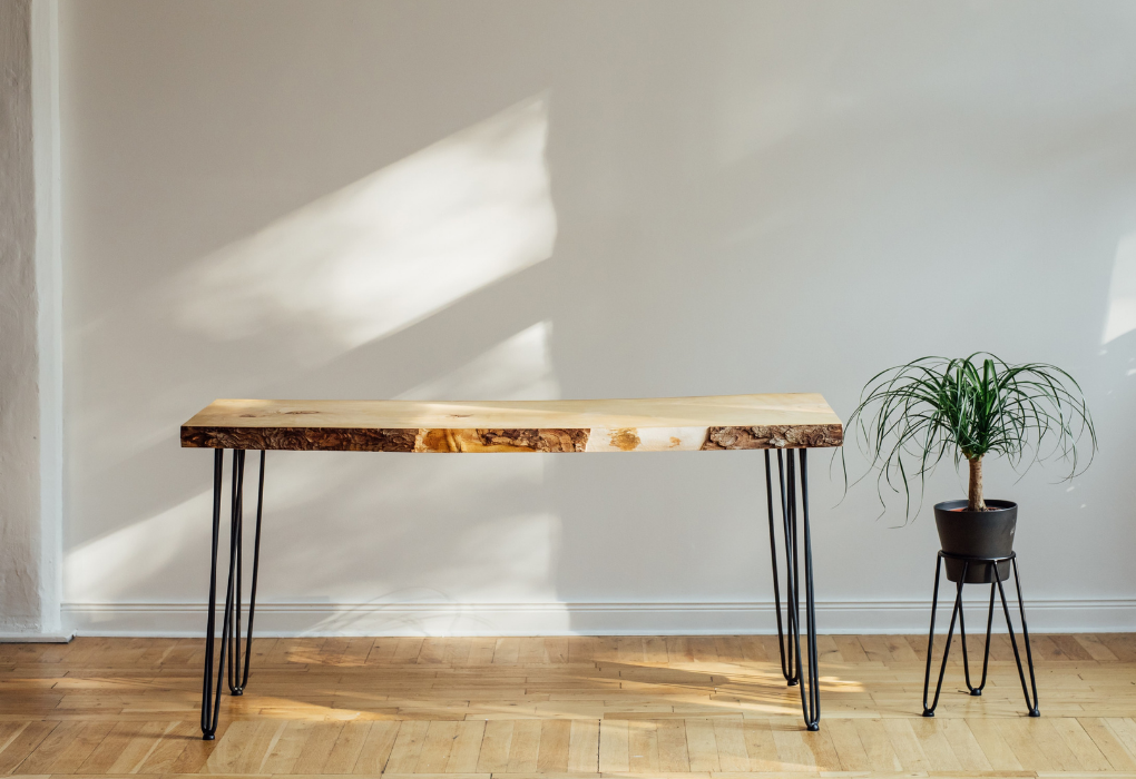 Raw wooden table with metal legs