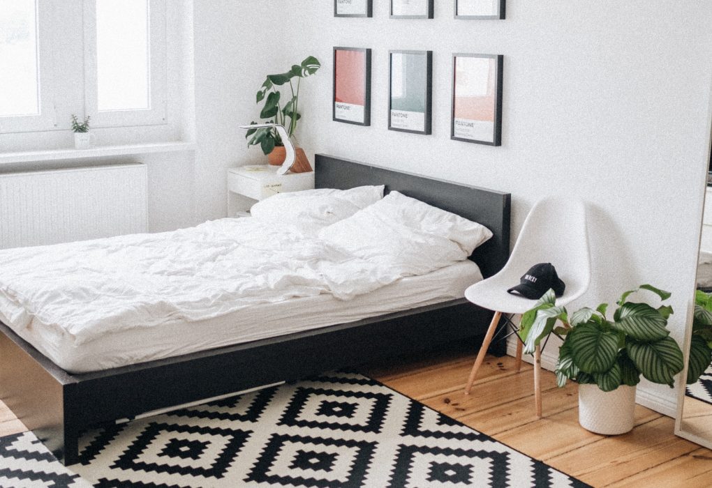 White bedroom with printed black and white rug