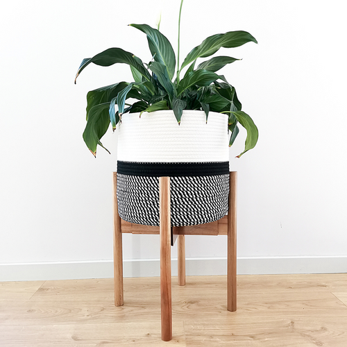 "These plant holders are adjustable and handcrafted to fit plant pots between the sizes of 8-12"" wide. Each planter stand can also be adjusted and flipped upside down so you can choose between different heights."