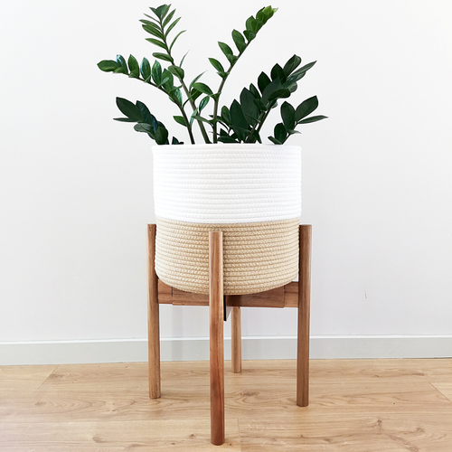 The plant stand and beige plant pot cover is the perfect boho accessory for your plants. These plant decor are handmade from natural materials - cotton rope and wood, making them an eco-friendly and sustainable boho option for your housing plants in your living room, kitchen, bedroom, or anywhere in your house.