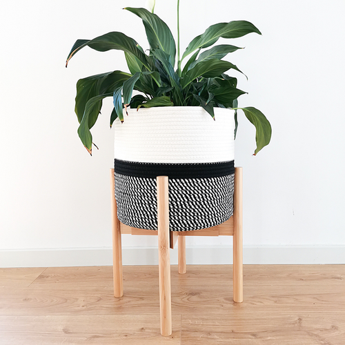 Plant stand and basket made from natural bamboo wood and cotton rope. Perfect for mid-century modern interior.