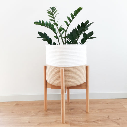 Minimalist wood plant stand with a classic mid-century modern style. These tall planter stands can be turned upside down to make your plants more eye-catching. They can also be adjusted to fit different pot sizes.
