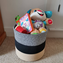 Load image into Gallery viewer, Handwoven cotton rope basket for storing toys, yoga mats, gym equipment, magazines, and other knick knacks. Great for tidying up small spaces.