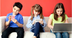 Children sitting using technology