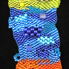 Closeup of blue segment of Freeform peyote bracelet using beads from www.beadstampede.co.uk