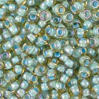 Toho 8/0 Round Seed Beads 8-0952 Sea Foam-Lined Rainbow Light Topaz