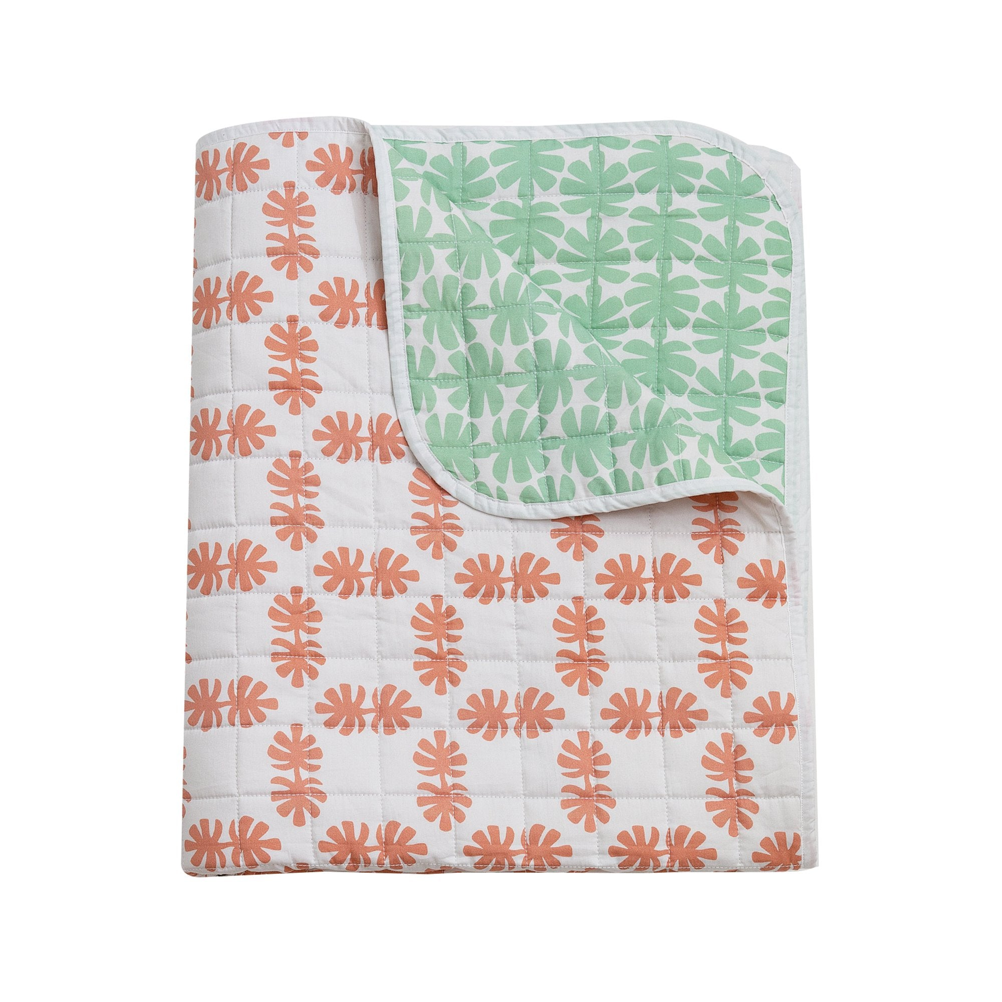Kikau's Coral and Green Coconut Palm Quilted Bedspread on white background