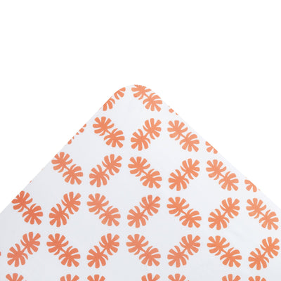 Kikau's Coral Orange Coco Palm kids fitted sheet on white background