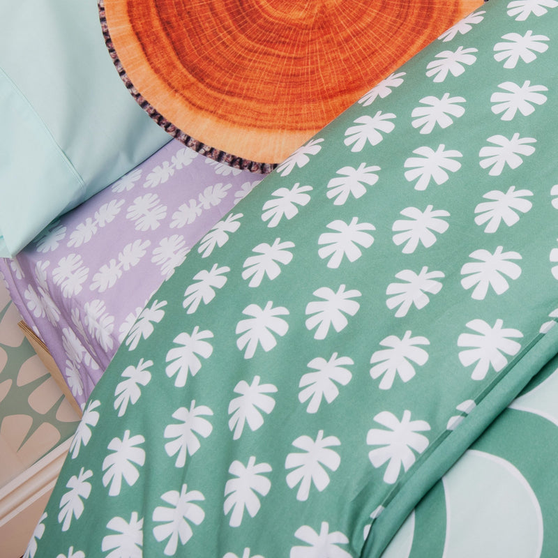 Kikau's Lots of Lilac Coconut Palm kids fitted sheet on white background