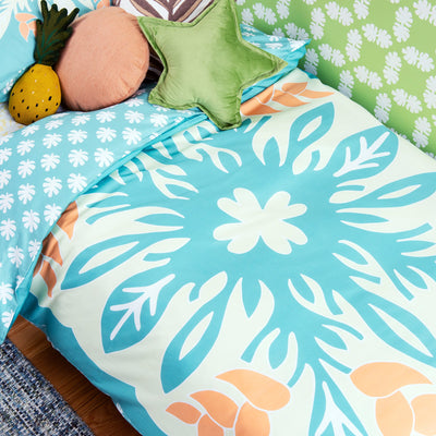 Birds eye view of single bed with Kikau's Lemon Yellow Coconut Palm printed sheets and Sea Foam Green kids quilt cover set