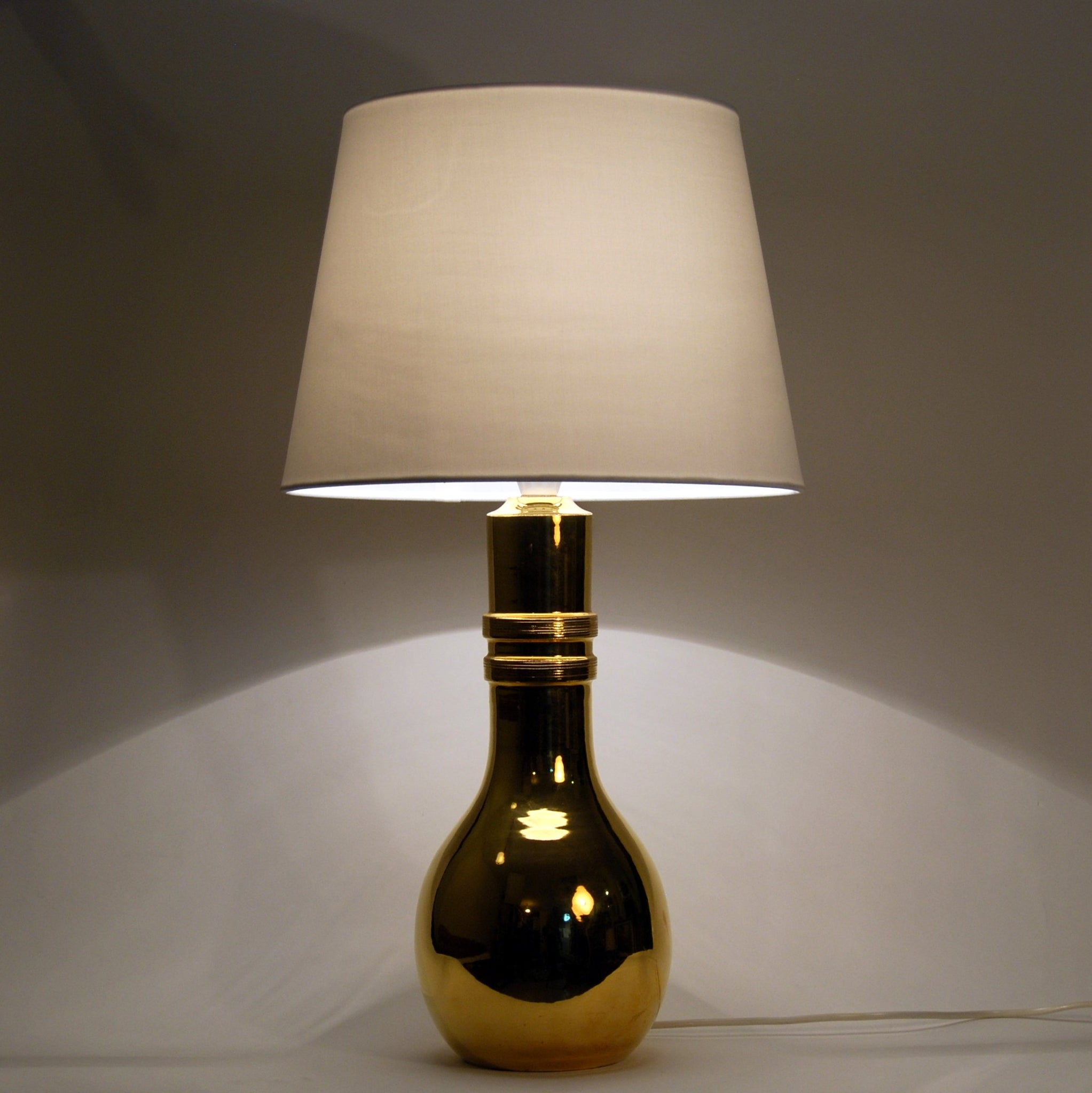 Gilt ceramic table lamp manufactured by Bitossi Italy and imported to Sweden by Miranda AB in the early 1970s