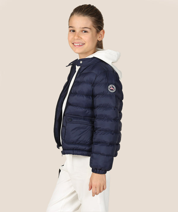Girl in puffy navy blue jacket for kids