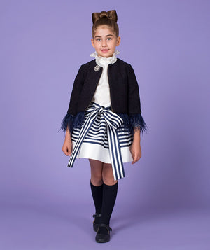Girl in chic outfit for kids with frilly luxury jacket by Mama Luma