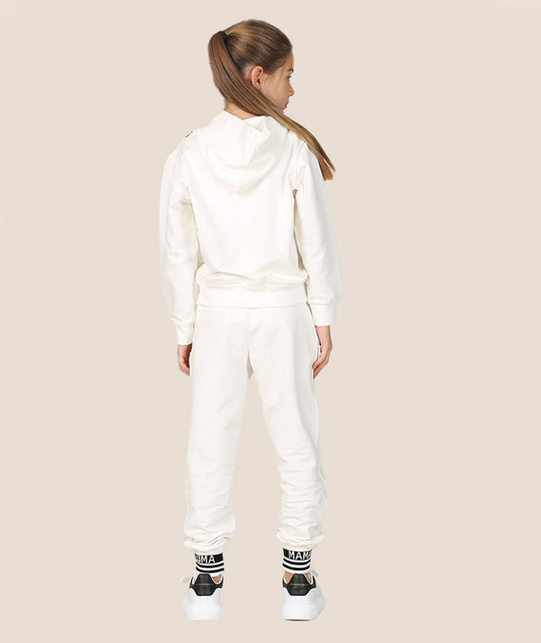 Back of girl in white and black athleisure tracksuit by Mama Luma