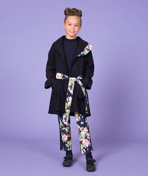 Girl in luxurious jacket for kids and floral print pants