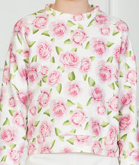 Girl in pink and white floral casual outfit with long sleeves for kids