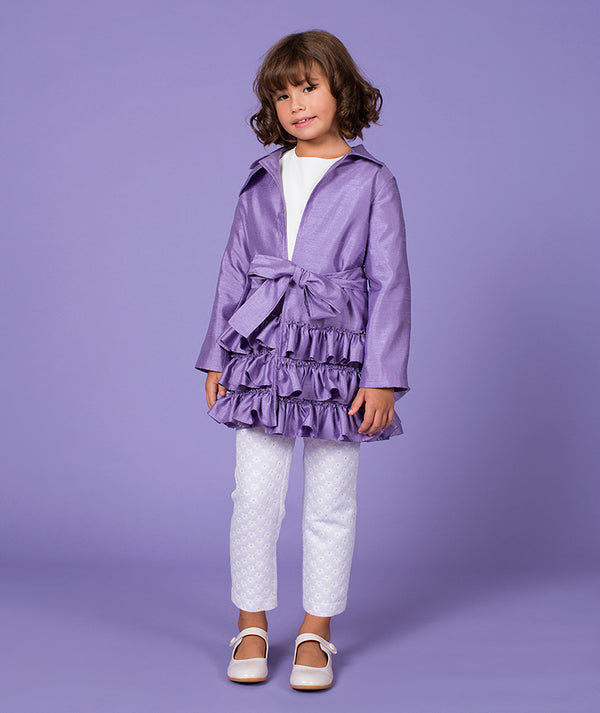 Girl in purple coat with ruffles and daisy pants by Mama Luma