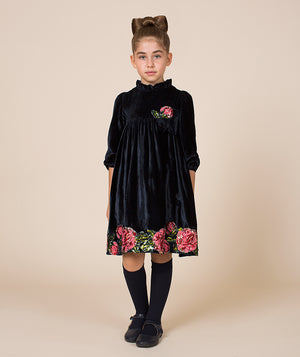 Girl in black velvet designer dress with roses by Mama Luma