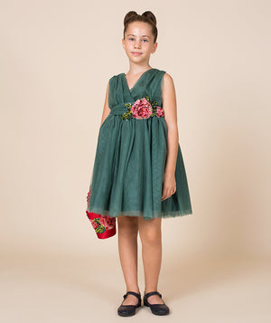 Girl in green holiday dress for kids by Mama Luma