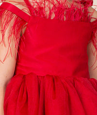 Red special occasion dress with feathers by Mama Luma