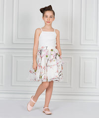 Girl in high fashion white blouse and chiffon flower print skirt for kids