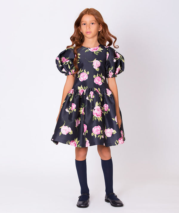 Girl in navy blue dress with rose flower print and balloon shoulders for kids