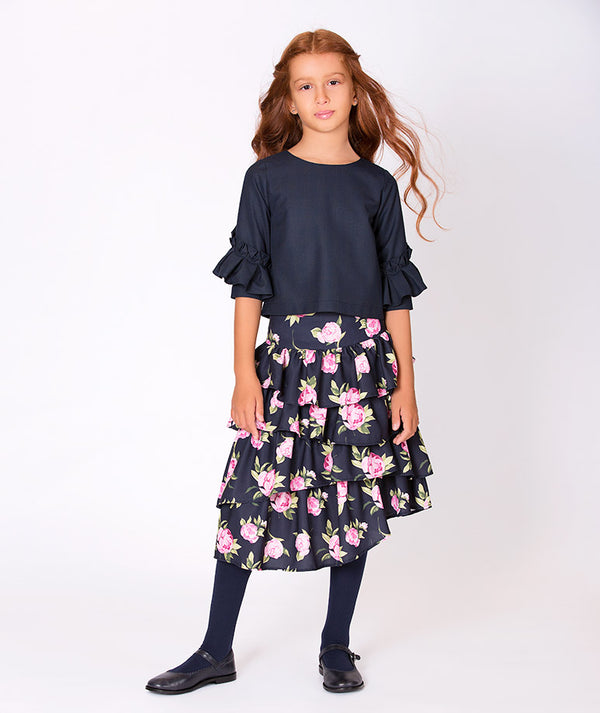 Girl in blue cotton blouse with pleated rose skirt for kids