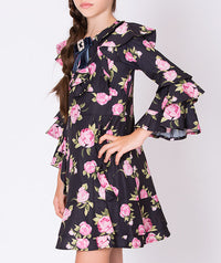 Girl in navy chiffon rose print dress with ruffle shoulders for kids