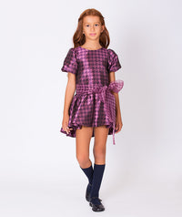 Girl in patterned shiny purple dress for girls with bow