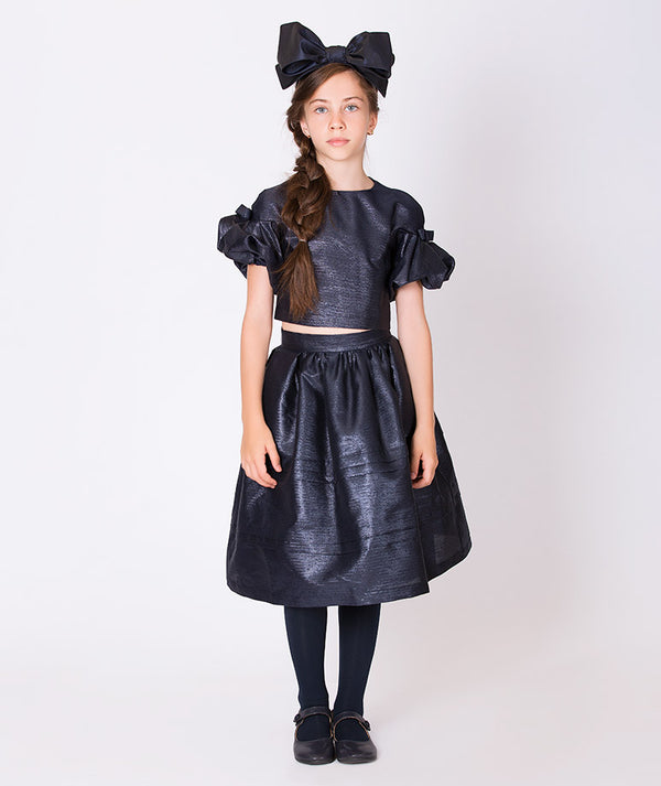 Girl in elegant navy blue skirt with ruffle blue blouse for special occasions for kids
