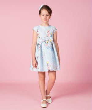Girl in light blue floral print dress for kids by Mama Luma