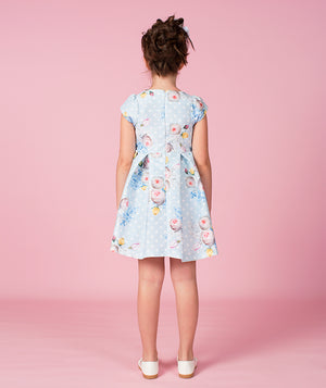 Back of girl in light blue floral print designer dress for kids by Mama Luma