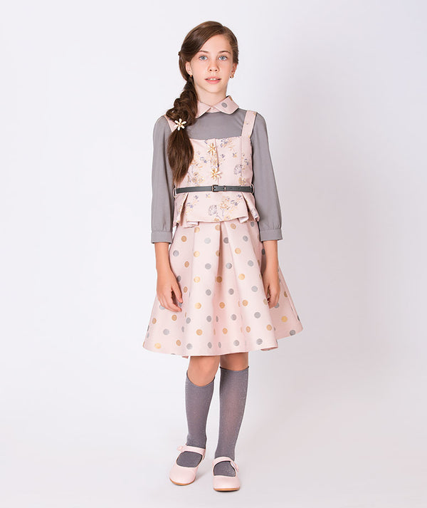 Girl in gray blouse with pink collar, pink vest and polka dot pink skirt for kids